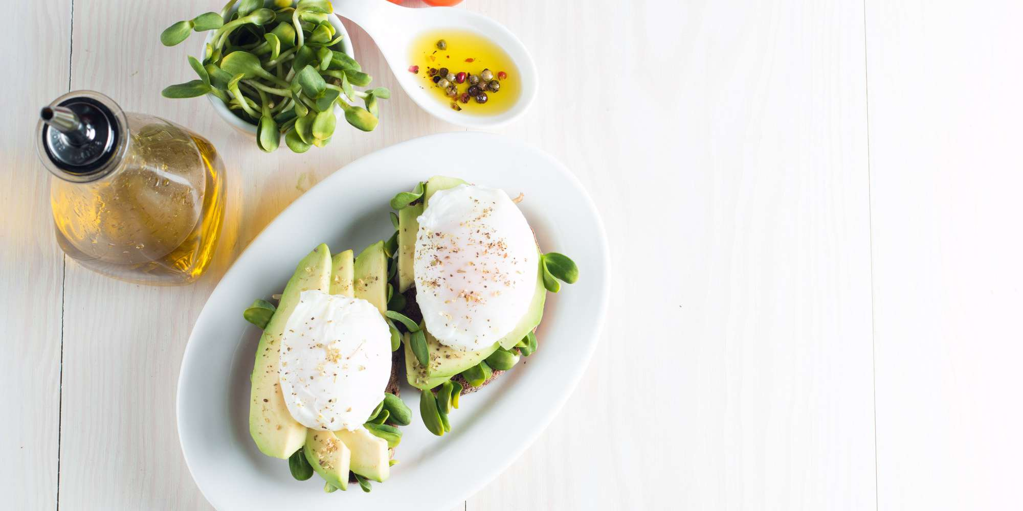 Avocado Toast with Eggs, Spinach and Tomatoes