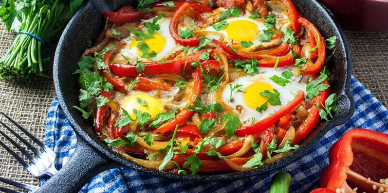 Baked Eggs Skillet With Red Peppers and Onions